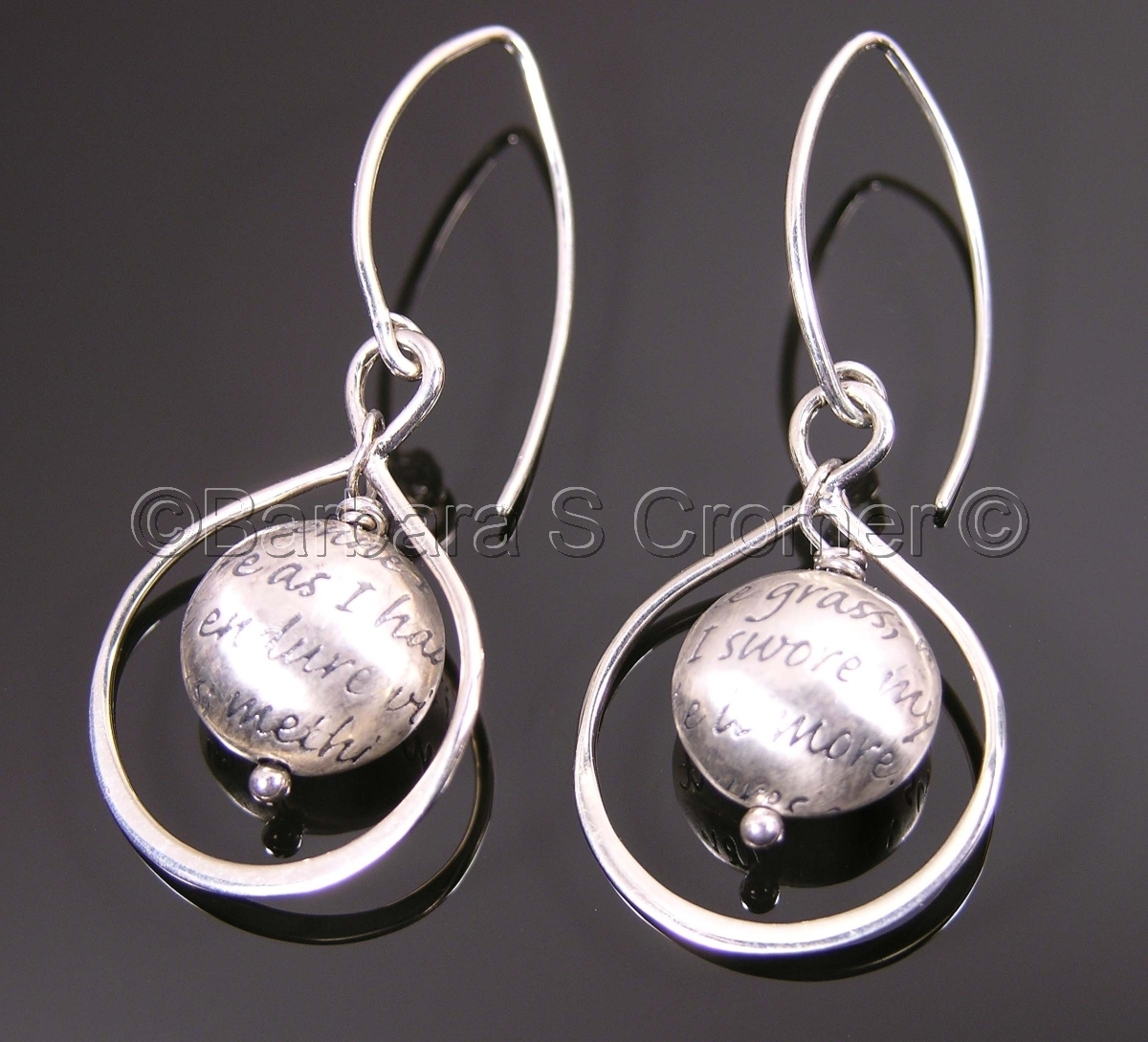 engraved with a portion of a sonnet by John Donne, Round bead, encircled by handmade Sterling silver shapes and hang from marquise ear wires, 2 inches (large view)