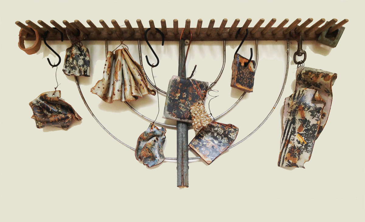 ceramic works suspended from wood rake (large view)