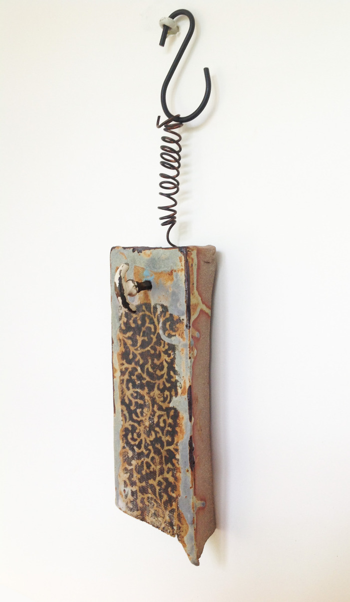 ceramic works suspended from metal (large view)